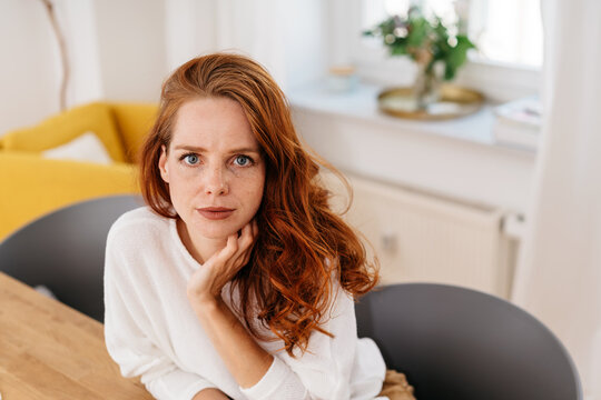 Troubled young woman looking intently at camera