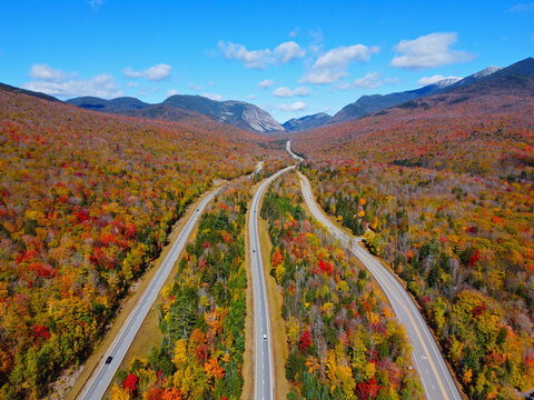 Interstate Highway I-93 across Franconia Notch between Cannon Mountain and Mount Lafayette with fall foliage in Franconia Notch State Park in White Mountain, Lincoln, New Hampshire NH, USA.