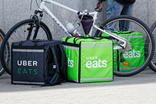 WARSAW/POLAND - June 16, 2018: View on Uber Eats bags leaving on the street and bikes