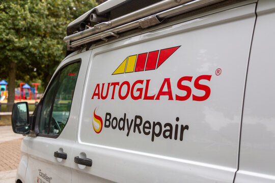 06/06/2019 Portsmouth, Hampshire, UK An autoglass body repair logo on the side of a white van