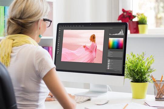 Graphic design artist editing photo on computer