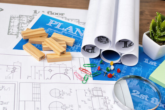 The architect's hands on the drawings are developing a construction plan. Business and Construction