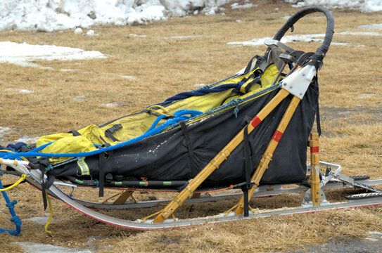 Sleds use in sled dog travel; often a winter sport for leisure or competitive racing.