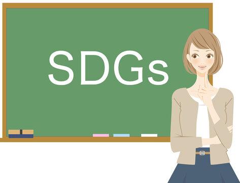 SDGs(持続可能な開発目標)を考える女性 黒板