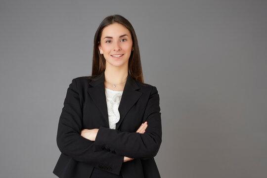young businesswoman posing instudio background