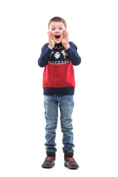 Happy excited little kid announcing and shouting with cupped hands around mouth. Full body portrait isolated on white background.