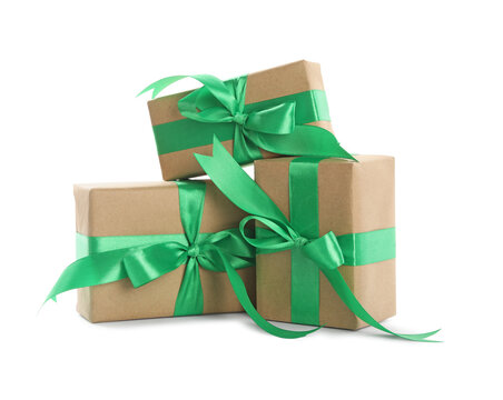Christmas gift boxes decorated with green bows on white background
