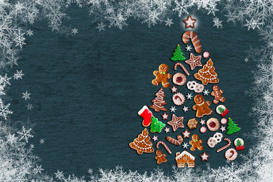 Christmas tree made from cookies on aged wooden background
