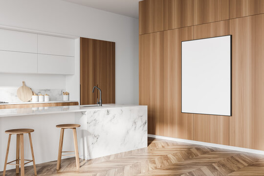 White and wooden kitchen corner with bar and poster