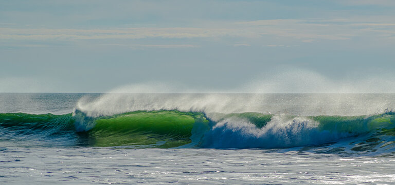 Vendée, France: from the Sauzaie spot, a long and very beautiful green wave in a roll, Bretignolles Sur Mer.