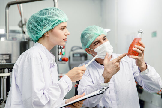 Quality control and food safety team inspection the product standard in the food and drink factory production line.