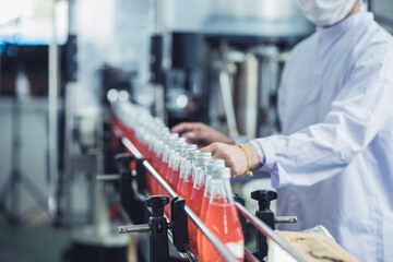 Drink factory - closeup hygiene worker working check juice glass bottled in production line