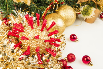 Golden Christmas coronavirus and other baubles isolated on white background