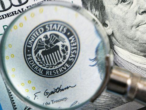 magnifying glass inspect paper money, finances and exchange, closeup