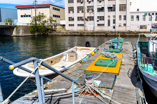 A barge floating on a canal in Otaru, Hokkaido, Japan