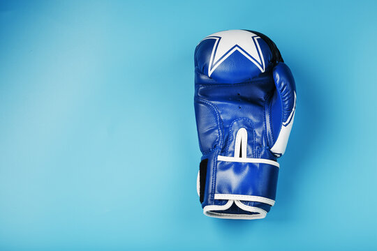 Blue Boxing glove on a blue background with free space