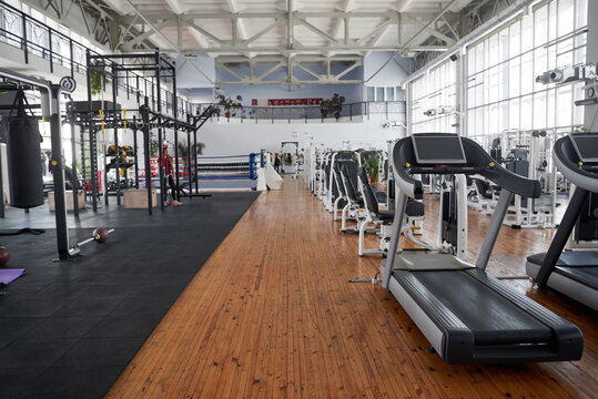 Gym interior with equipment. Treadmills for fitness cardio training. Sport club for fitness workout.