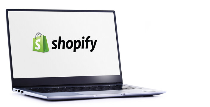 Laptop computer displaying logo of Shopify