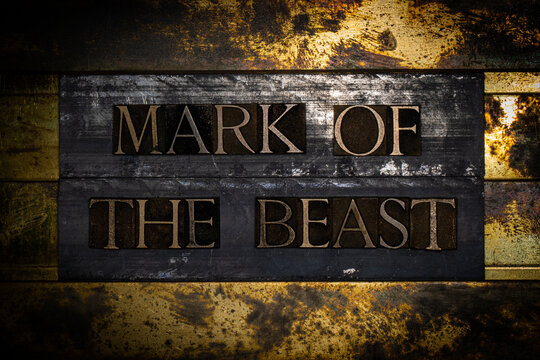 Mark Of The Beast text on textured grunge copper and vintage gold background