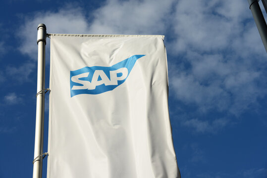 Dresden, Saxony, Germany - September 26, 2019: Flag with SAP logo in front of SAP office in Dresden, Germany - SAP is a German based multinational software corporation