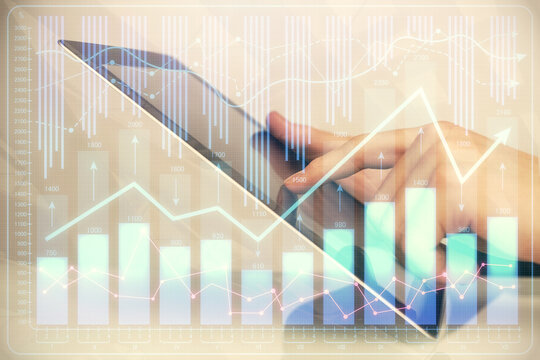 Multi exposure of man's hands holding and using a digital phone and forex graph drawing. Financial market concept.