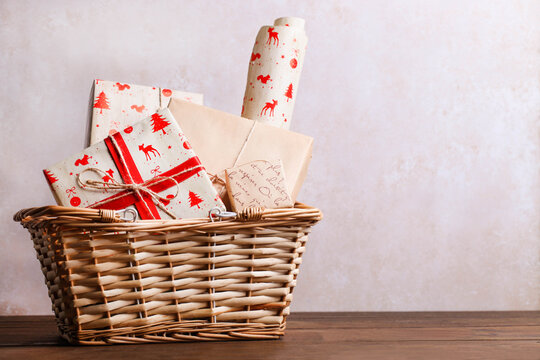 Wrapped Christmas gifts in a storage basket