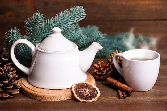 Teapot and hot drink cup with new year decor