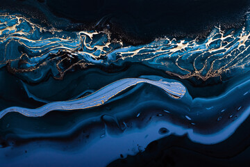 Fluid Art. Liquid Metallic Gold in abstract blue wave. Marble effect background or texture