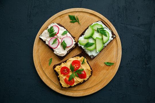 Top view vegetarian rye bread open sandwiches