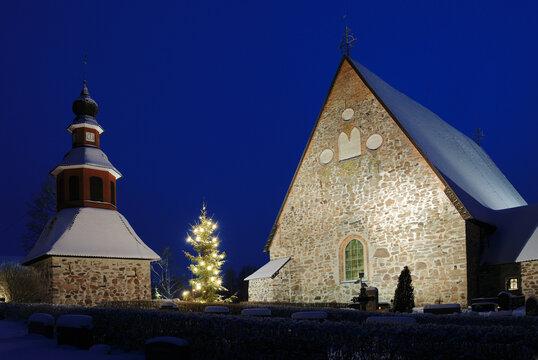 christmas night scenery in Finland, church in snow, xmas tree
