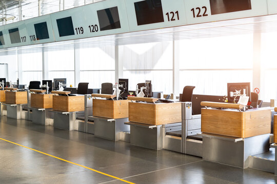 International airport terminal indoors registration empty check-in counter desk closed due to covid pandemic lockdown, cancelled suspended flight. Airways and travel agency bankruptcy at coronavirus