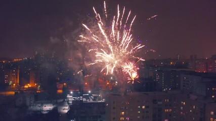 Fotobehang - Local fireworks celebrating New Year Eve in residential neighborhood of Yekaterinburg, Russia. Drone aerial view, 4K UHD.