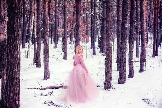 Woman in a winter forest with snow