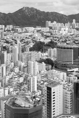 Fototapete - Mountain Lion Rock and downtown district of Hong Kong city