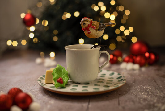 cup of coffee with christmas sparrow on top