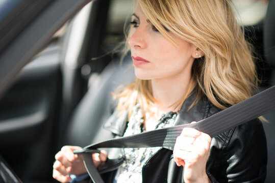 Woman putting safety belt on
