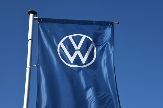 Hanover, Lower Saxony, Germany - April 5, 2020: Flag with the new logo of Volkswagen AG in Hanover, Germany - VW is one of the world's leading manufacturers of automobiles
