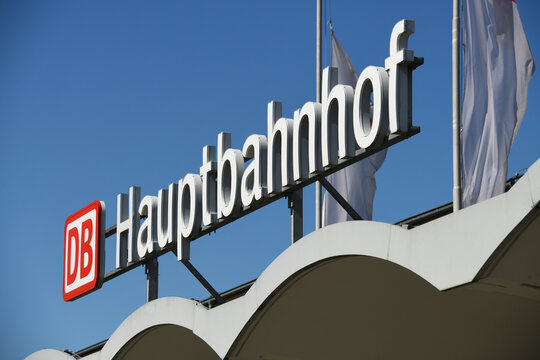 """Wolfsburg, Lower Saxony, Germany - April 6, 2020: The Deutsche Bahn logo and the lettering """"Hauptbahnhof"""" (main station) in Wolfsburg - DB is a German railway company"""