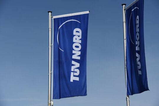 Celle, Lower Saxony, Germany - April 10, 2020:  Flags with the TUV Nord logo (Technical Inspection Association) in Celle, Germany - TÜV Nord is a technical service provider with worldwide activities