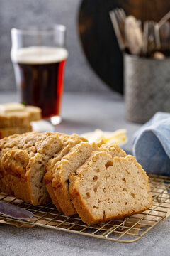 Beer bread on a cooling rack served with butter