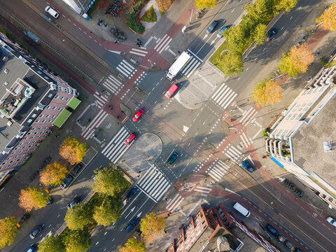 Crossroad crossing aerial view in Amsterdam traffic intersection in city urban The Netherlands