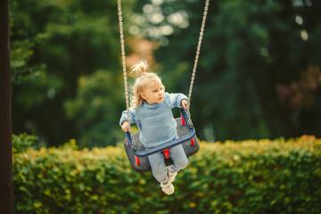 Fototapeta blonde haired girl on the swing