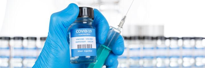 Coronavirus Vaccine bottle Corona Virus COVID-19 Covid vaccines syringe panoramic view copyspace...