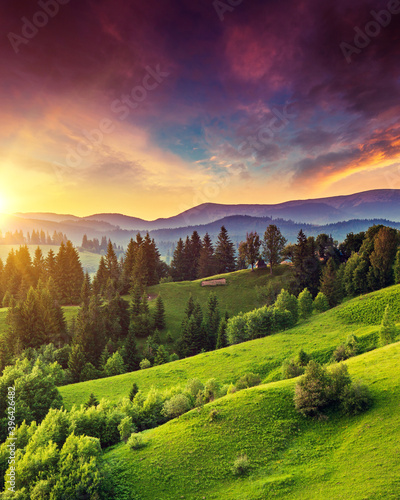 Wall mural Majestic mountain landscape with colorful cloud.