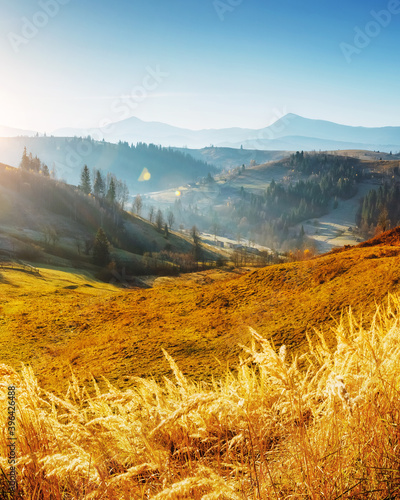 Wall mural Beautiful sunny day in magnificent mountain landscape.