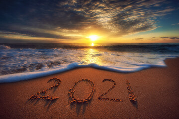 Happy New Year 2021 concept, lettering on the beach. Sea sunrise