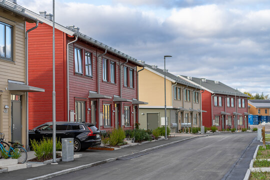Street with Scandinavian style townhouses or condominium apartments