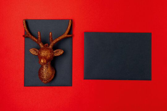 flat lay with christmas reindeer on red background