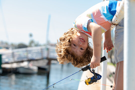 Funny little child fishing on the sea.