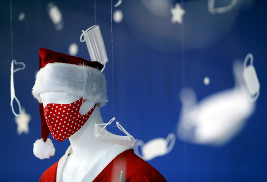 A mannequin of Santa Claus wearing a face mask is displayed at a photo spot featuring Christmas season scene and masks at Tokyo Mask Land, amid the coronavirus disease (COVID-19) outbreak, in Yokohama
